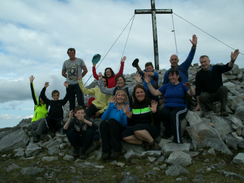 walkers at the cross of Muckish